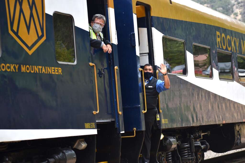 Train crews wave to the crowd during the Rocky Mountaineer's maiden voyage between Denver and Moab Sunday, Aug. 15, 2021 with a stopover in Glenwood Springs.