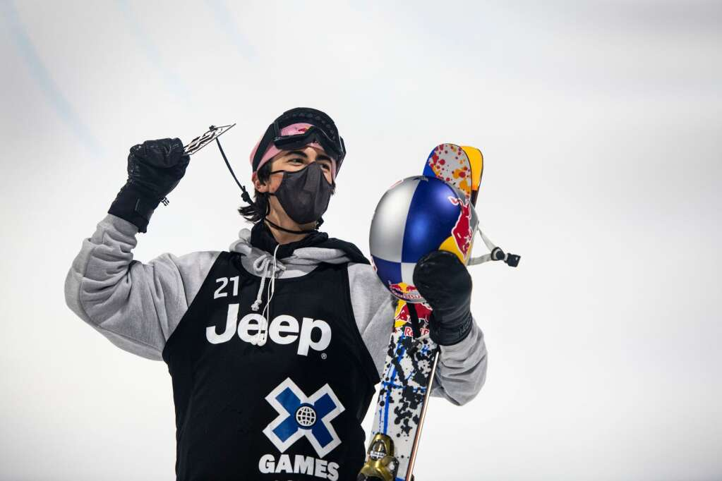 American freestyle skier Birk Irving holds up his bronze medal on the podium for men's ski superpipe at the 2021 X Games Aspen at Buttermilk on Friday, Jan. 29, 2021. (Kelsey Brunner/The Aspen Times)