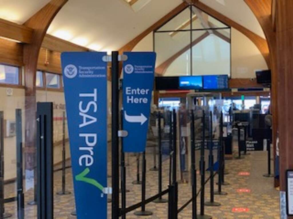 Aspen-Pitkin County Airport personnel put in COVID-19 PPE measures in March, like Plexiglas for TSA screeners.