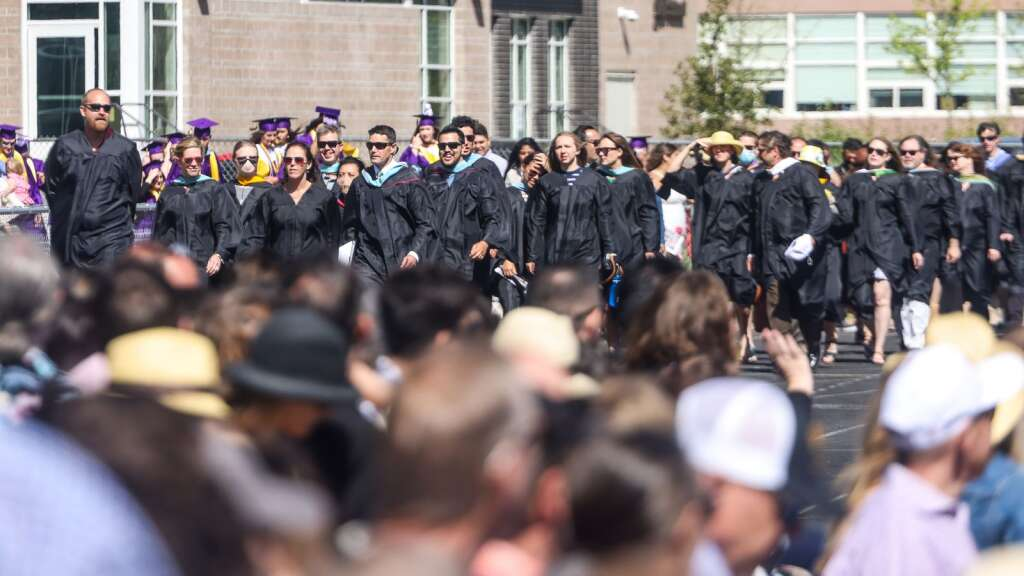 Teachers and staff walk onto the field at the start of the Basalt High School graduation ceremony on Saturday, May 22, 2021, on the BHS football field. Photo by Austin Colbert/The Aspen Times.