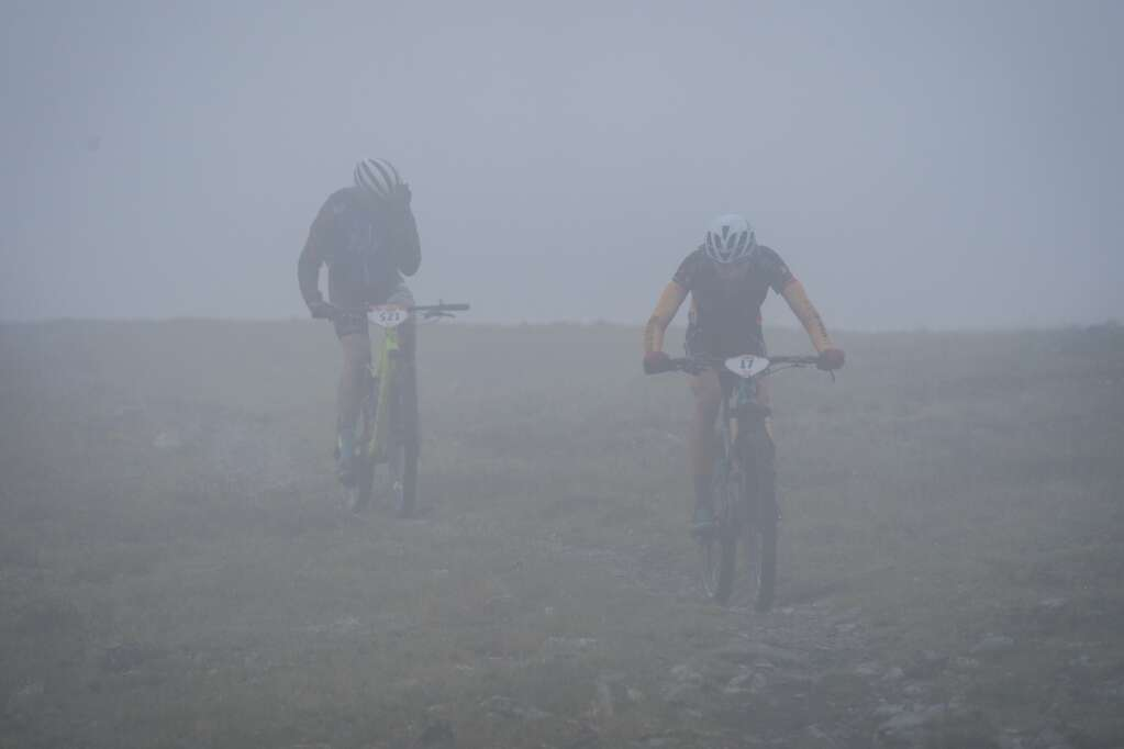 Mountain bikers ride through the clouds during Thursday's fifth stage of the six-day Breck Epic mountain bike race.   Photo by Devon Balet / Breck Epic