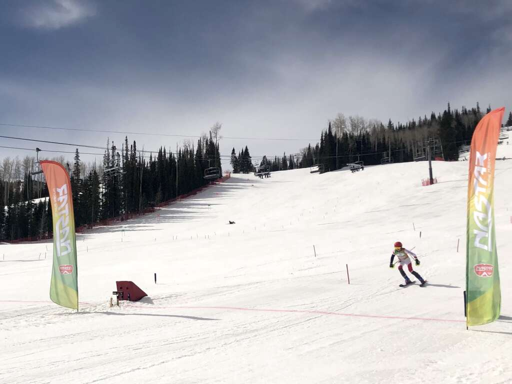 A skier approaches the finish line during the slalom warm-up race at NASTAR national championships at Snowmass on April 5, 2021. | Kaya Williams/The Aspen Times