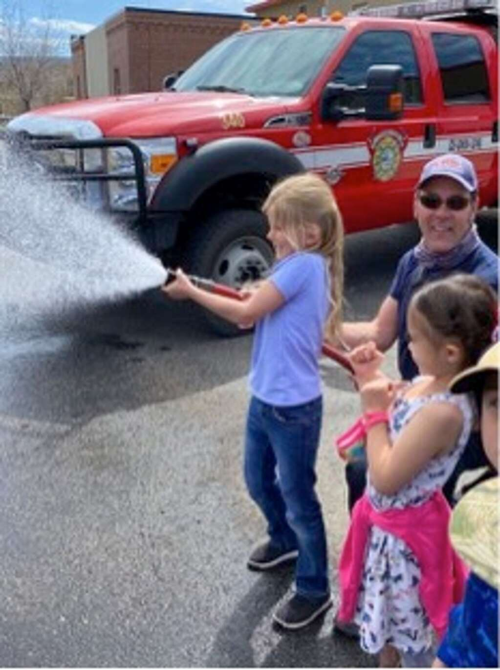 Granby Elementary kindergartners take turns spraying the Grand Fire firehose during a field trip to Kaibab Park. | Photos courtesy East Grand School District