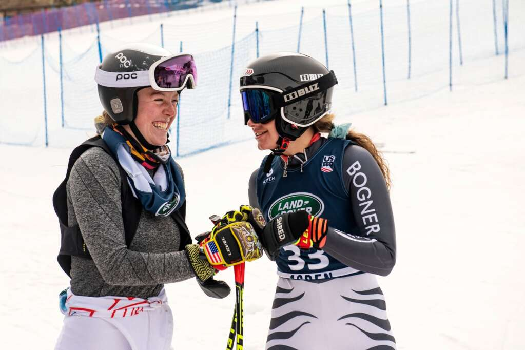 American alpine skiers AJ Hunt, left, and Resi Stiegler share a moment at the bottom of Aspen Highlands after finishing the Women's Super G FIS event on Tuesday, April 13, 2021. (Kelsey Brunner/The Aspen Times)