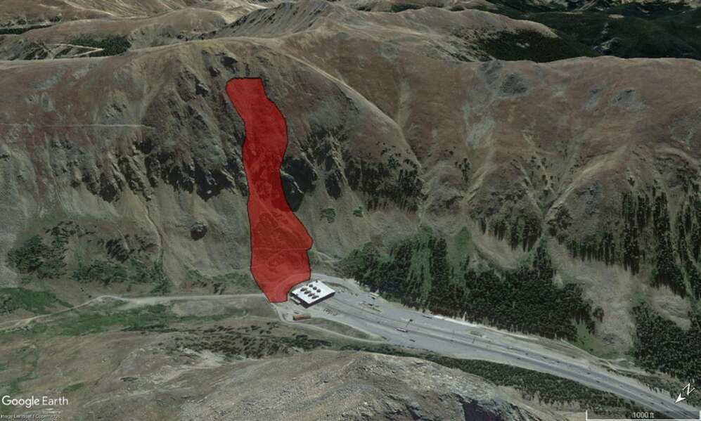 An overview of the March 25, 2020, avalanche site near the Eisenhower Johnson Memorial Tunnels via  Google Earth. The red area outlines the approximate extent of the avalanche. The large structure is the west portal of tunnels on Interstate 70. | Courtesy Colorado Avalanche Information Center