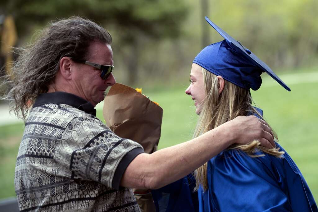Chris Bryant, left, embraces his daughter Saxan Netzel after she received her diploma during the Snowy Peaks High School graduation Wednesday, May 26, at the Silverthorne Performing Arts Center in Silverthorne.   Photo by Jason Connolly / Jason Connolly Photography