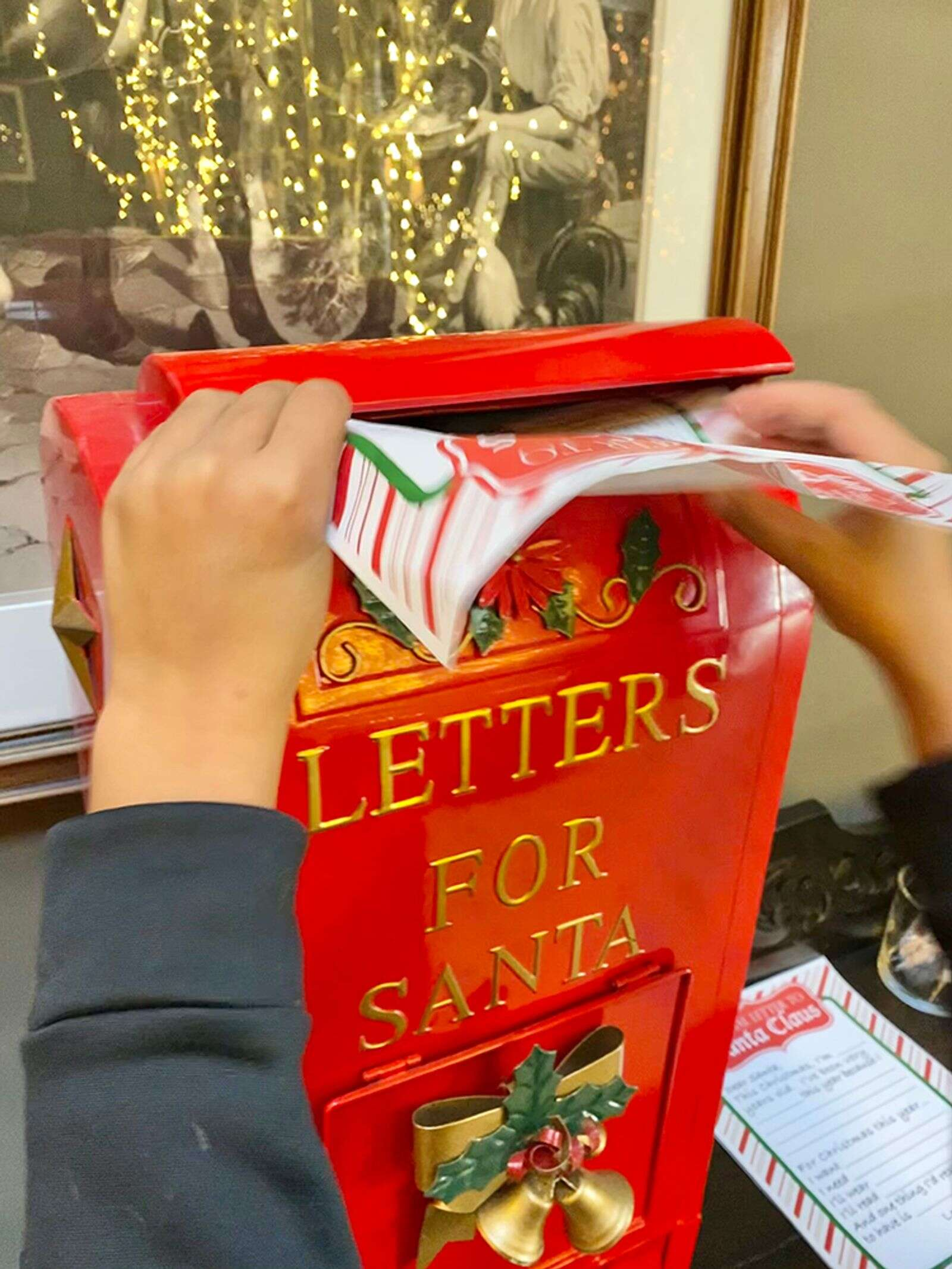 Signing, sealing and delivering a letter to Santa for the mailbox in the Hotel Jerome lobby.