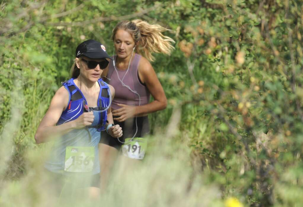 Ashley Neff and Emily Stout compete in the Steamboat Springs Running Series Howelsen Hill Trail Run on Saturday morning. (Photo by Shelby Reardon)