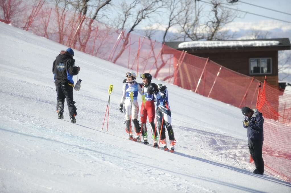 Steamboat Springs Winter Sports Club skiers Jaelie Hovey, Ryli Adrian and Isabelle Washburn pose partway down the slalom course after they were unable to complete the first run during the Colorado Ski Cup at Steamboat Resort on Wednesday, March 30. (Photo by Shelby Reardon)
