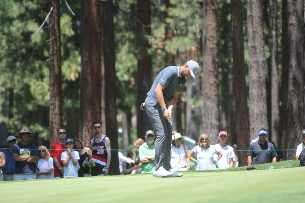 Defending champ Mardy Fish putts.