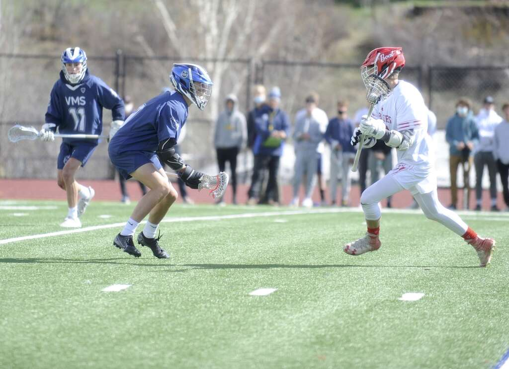 Steamboat Springs junior Tommy Meissner carries the ball into the offensive zone during a game against the Vail Mountain boys lacrosse team at home on Tuesday. (Photo by Shelby Reardon)