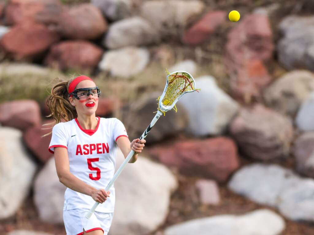 Aspen High School girls lacrosse player Kylie Kenny makes a pass against Battle Mountain on Wednesday, May 12, 2021, on the AHS turf. The Skiers won, 8-6. Photo by Austin Colbert/The Aspen Times.