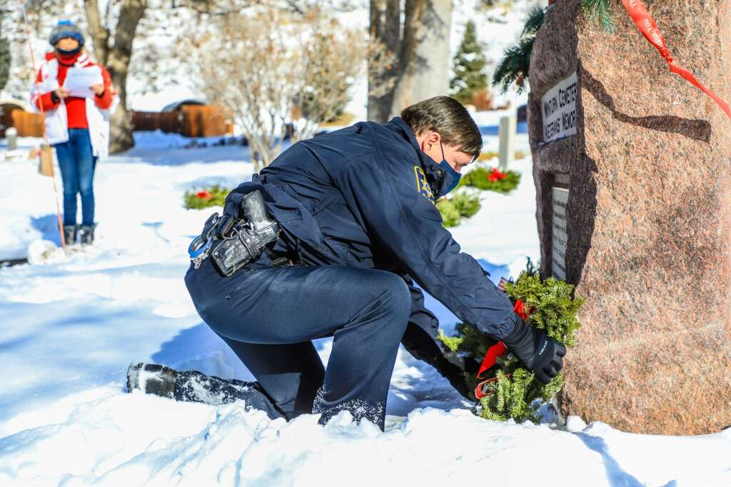 Eagle County Sheriff Deputy Mark Linn lays a wreath for the Wreaths Across America Saturday in Minturn. More than 2,500 locations around the country celebrated laying wreaths for those who served in the armed forces. | Chris Dillmann/cdillmann@vaildaily.com