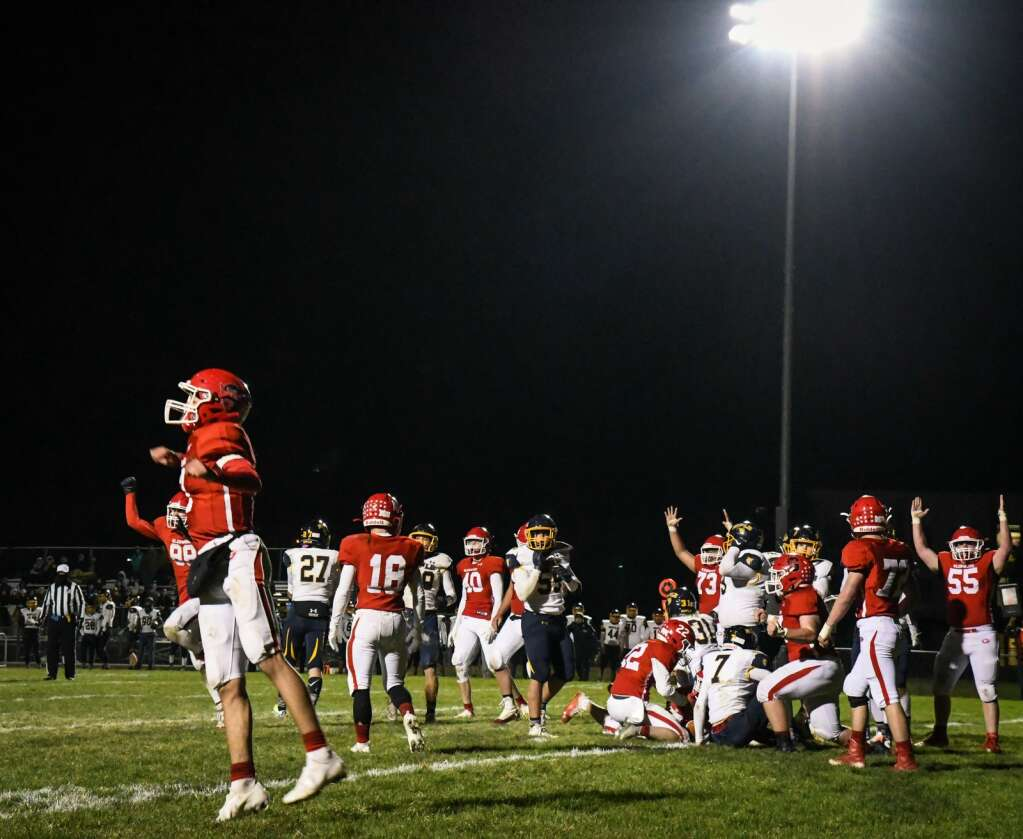 The Glenwood Springs Demons react after scoring against the Rifle Bears during Friday night's rivalry game at Stubler Memorial Field. |Chelsea Self / Post Independent