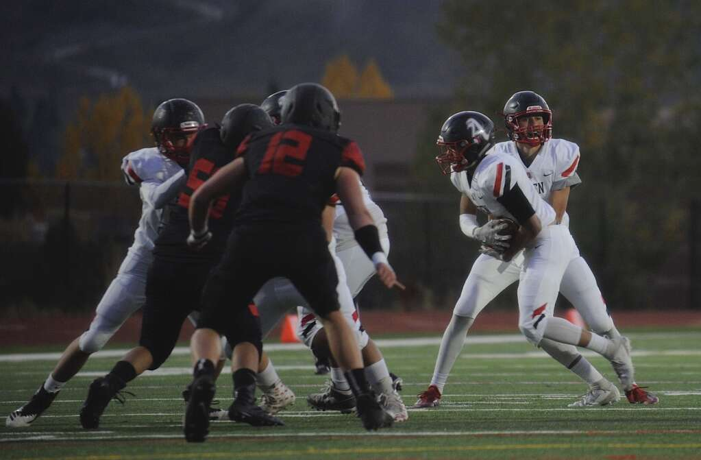 Aspen quarterback Porter Lee passes to his running back during the homecoming football game at Steamboat Springs on Friday night. | Shelby Reardon/Steamboat Pilot & Today