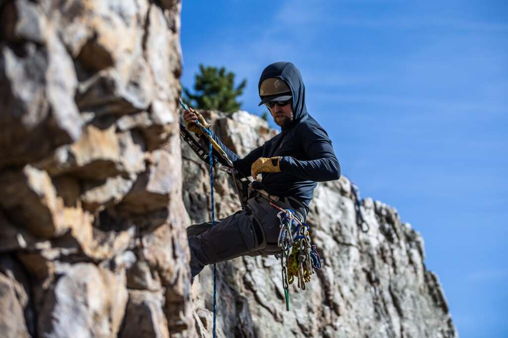 Wesley Laverty descends a rock face near Windy Point Campground during a search and rescue training course on Friday, September 24.  |  Liz Copan / For the Daily News Summit