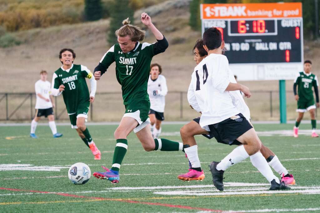 Gannon Heisler cuts though the defense during the Summit Tigers homecoming match against Battle Mountain on Tuesday, Sept. 21, at Tiger Stadium in Breckenridge. | John Hanson/For the Summit Daily News