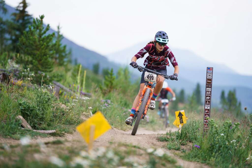 Victoria Uglyar maintains her lead in the junior expert girls 16-18 division as she nears the end of the 17-mile course at Wednesday's Soda Creek Scramble mountain bike race in Keystone.   Photo by John Hanson