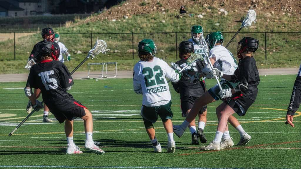The Summit High School varsity boys lacrosse team battles Aspen during a 10-4 loss at Summit High School in Breckenridge on Thursday, May 27, 2021. | Photo by Joel Wexler / Rocky Mountain.Photography