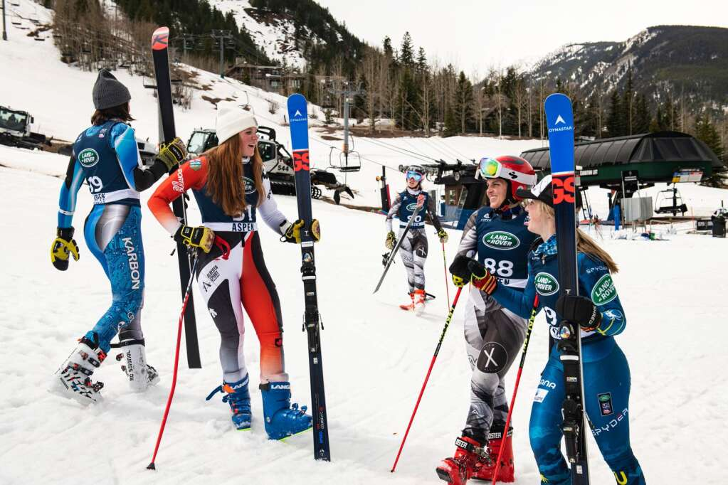 Alpine skiers wait to take the podium after finishing the Women's Giant Slalom National Championships at Aspen Highlands on Thursday, April 15, 2021. (Kelsey Brunner/The Aspen Times)