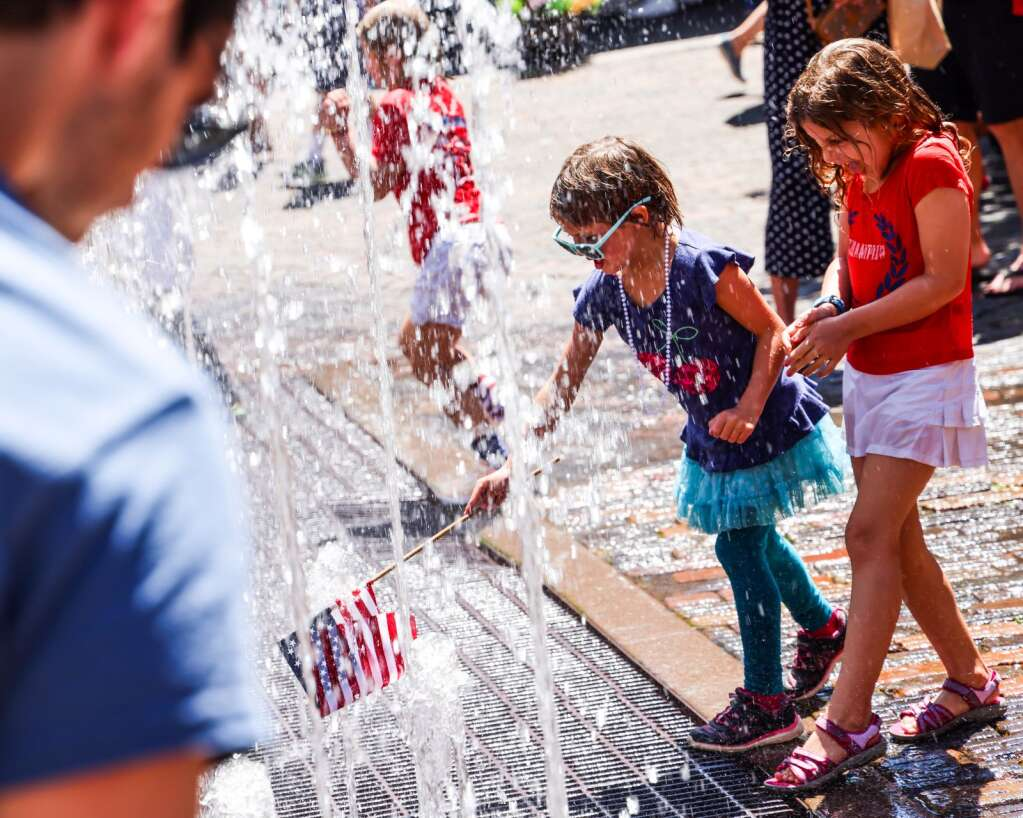 Children play in the fountain during the Fourth of July celebration on Sunday, July 4, 2021, in downtown Aspen. Photo by Austin Colbert/The Aspen Times.