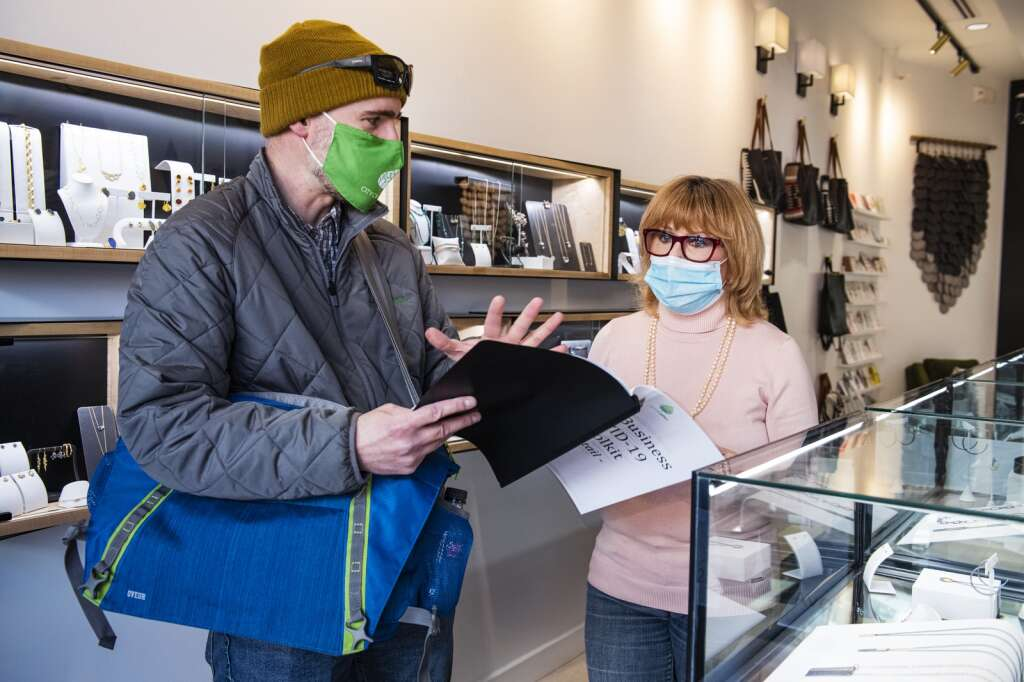 City of Aspen consumer health protection specialist Mike Sear talks to Jackie Pagnucco about the New Business COVID-19 Toolkit in Kate Maller Jewelry in Aspen on Friday, Jan. 15, 2021. (Kelsey Brunner/The Aspen Times)