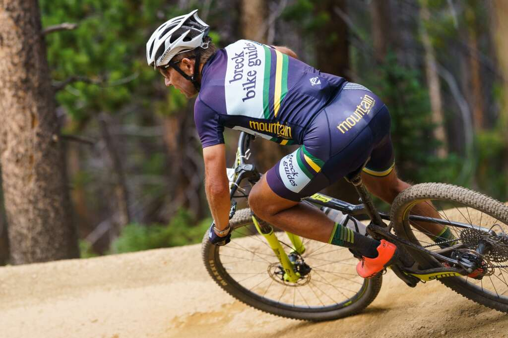 Michael Hagen of Breckinridge leans into a berm as he enjoys some of the excellent singletrack that made up this year's Fall Classic mountain bike race course in Breckenridge on Sunday. | Photo by John Hanson/For the Summit Daily News