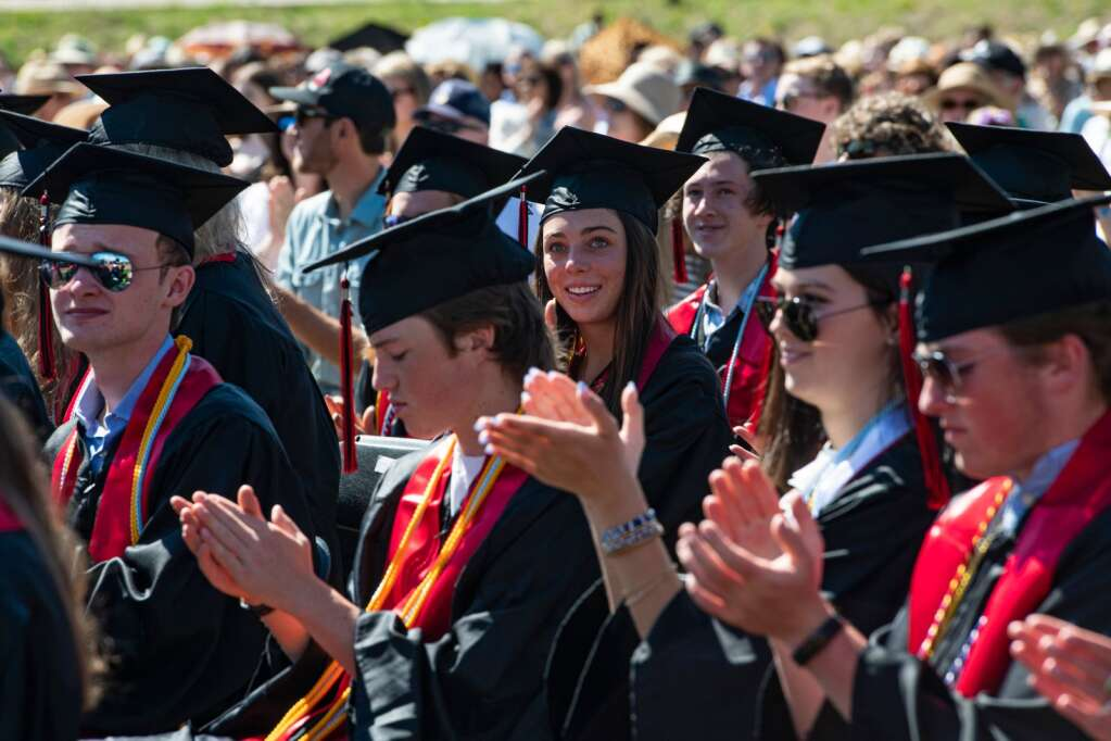 Aspen High School graduates applaud a speaker during the commencement ceremony on Saturday, June 5, 2021. (Kelsey Brunner/The Aspen Times)