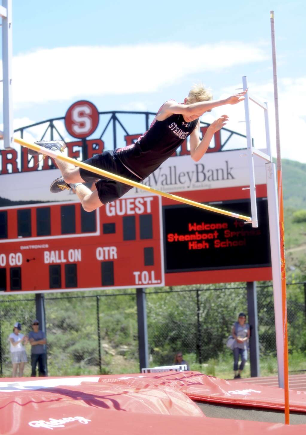 Steamboat Springs pole vaulter Olin Webster competes during a home track and field meet at Gardner Field on Saturday afternoon. (Shelby Reardon)