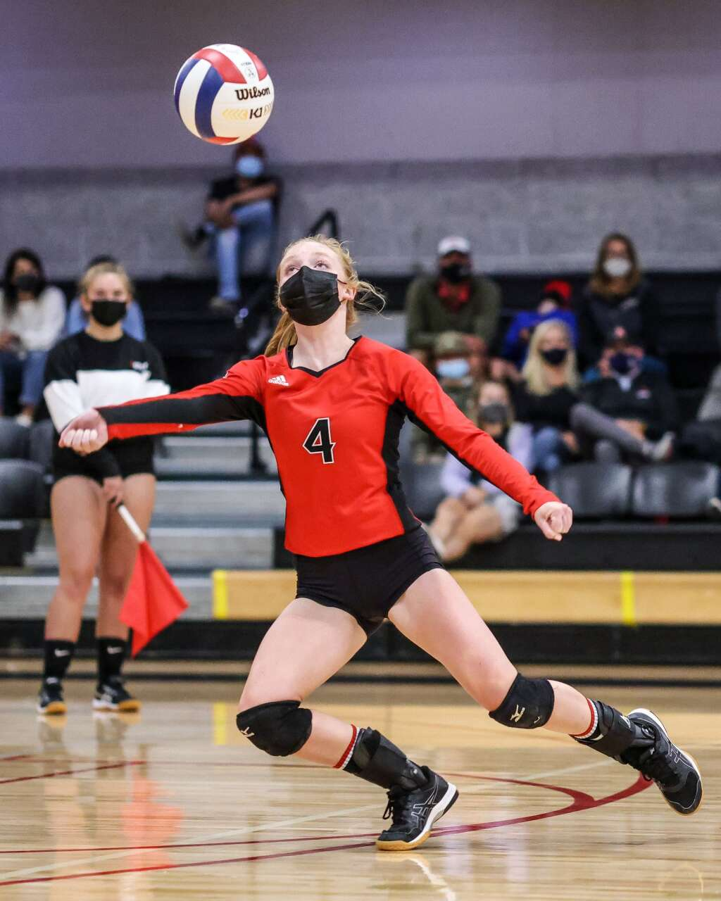 Aspen High School's Reese Leonard reaches for the ball as the AHS volleyball team hosts Glenwood Springs on Thursday, Aug. 19, 2021, inside the AHS gymnasium. The Skiers won, 3-2. Photo by Austin Colbert/The Aspen Times.