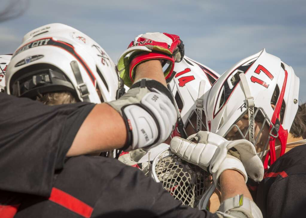 Park City High School boys varsity lacrosse teammates gather on the field following their 20-13 loss to Corner Canyon. (Tanzi Propst/Park Record)