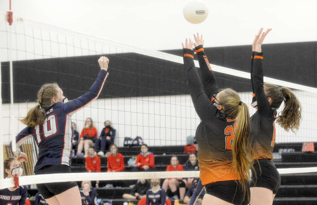 Hayden junior Piper Jo Jones and senior Leah Carrouth block a hit during a game against Caprock on Friday night. (Photo by Shelby Reardon)