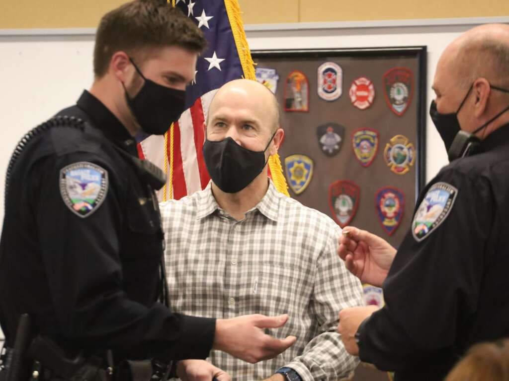 Basalt Police Officer Evan Wagstrom (left) is thanked for his role in saving Michael Latousek's life. It was Wagstrom's first day on the job with Basalt PD. Photo by Austin Colbert/The Aspen Times.
