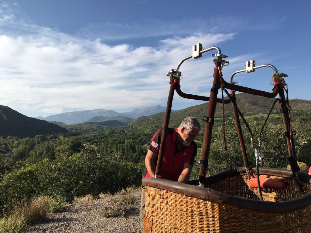 Kenny Bradley inspects his hot air balloon basket on Watson Divide Road in Old Snowmass after a downvalley flight for the Snowmass Balloon Festival on Friday, September 10, 2021. | Kaya Williams/The Aspen Times