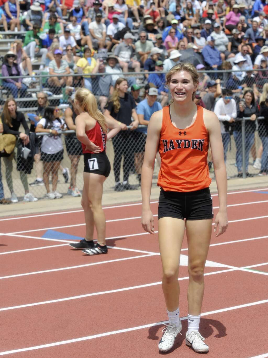 Hayden junior Jillian Bennett smiles as she sees her personal-best time of 59.25 in the 400. She earned second in the event at the CHSAA State Track and Field Championships at JeffCo Stadium on Saturday. (Photo by Shelby Reardon)