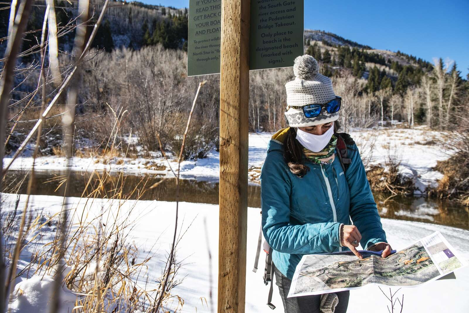 Pitkin County Open Space & Trails Liza Mitchell points out known active beaver lodges on a map of Northstar Nature Preserve in Aspen while scouting a place to put a wildlife camera near dams in this section of the Roaring Fork River on Friday, Dec. 4, 2020. (Kelsey Brunner/The Aspen Times)