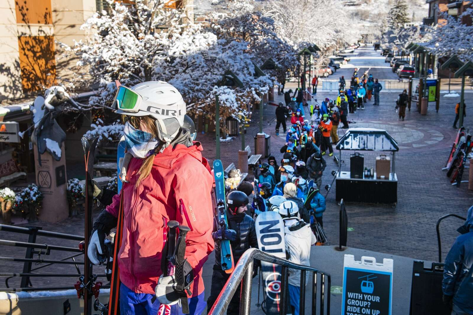 A line for the Silver Queen Gondola stretches out through gondola plaza at the base of Aspen Mountain on opening day on Wednesday, Nov. 25, 2020. (Kelsey Brunner/The Aspen Times)