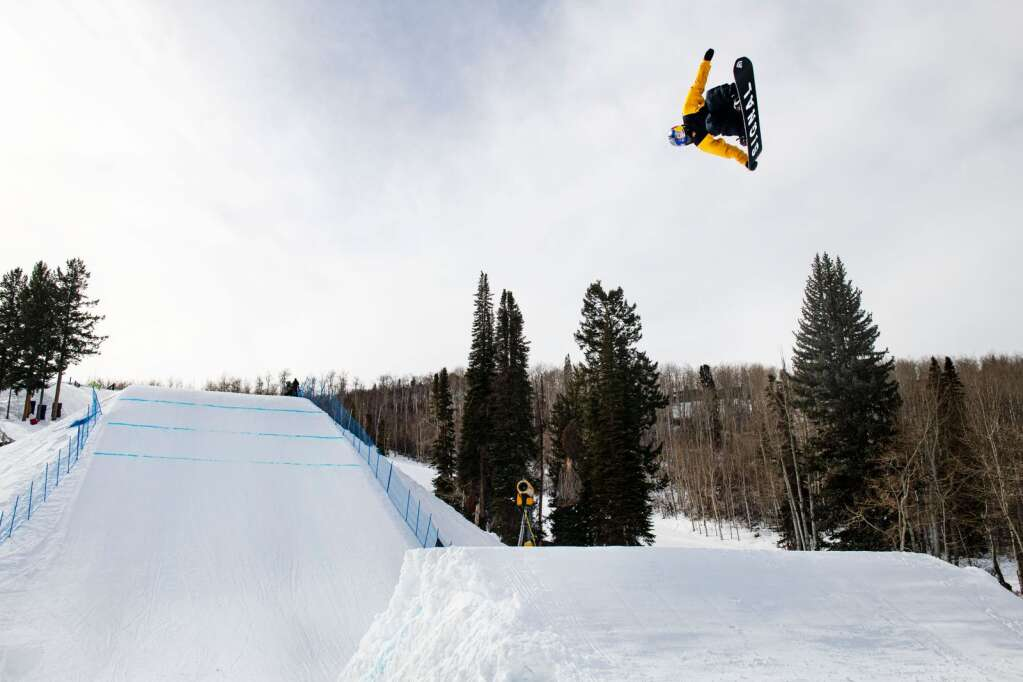 Snowboarder Yuki Kadono hits the second jump on the slopestyle course during a practice session at the 2021 X Games Aspen at Buttermilk on Thursday, Jan. 28, 2021. (Kelsey Brunner/The Aspen Times)