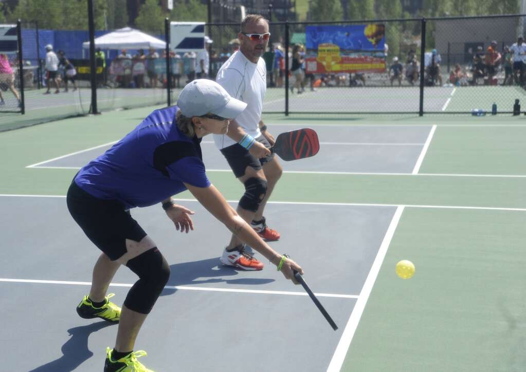 Gio Giovetti and Kevin Wesolowski compete in a mixed doubles game at the Steamboat Classic Pickleball Tournament on Saturday afternoon. (Photo by Shelby Reardon)