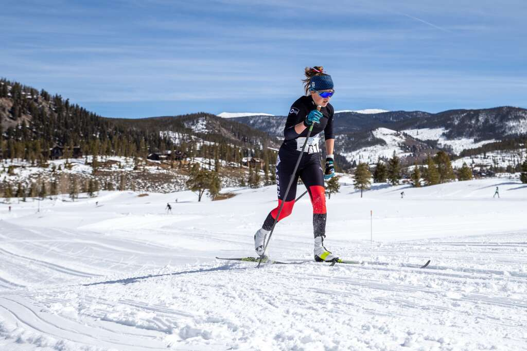 Aspens Elsie Weiss approaches the finish line in the 5k girls classic race at the 2021 Colorado Nordic Ski State Championships held at the Gold Run Nordic Center in Breckenridge on Saturday, March 6.  (photo by Liz Copan / Studio Copan)