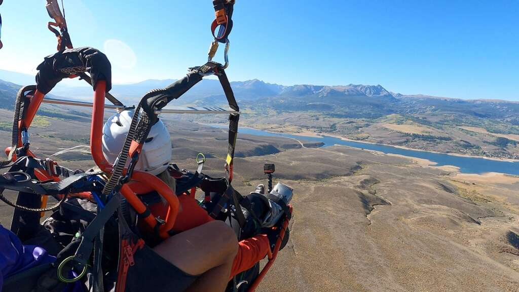 Charlie Martin pilots adaptive flier Danelle Herra in a Project Airtime tandem wheelchair from Williams Peak near Green Mountain Reservoir on Sept. 18. | Charlie Martin/Courtesy photo