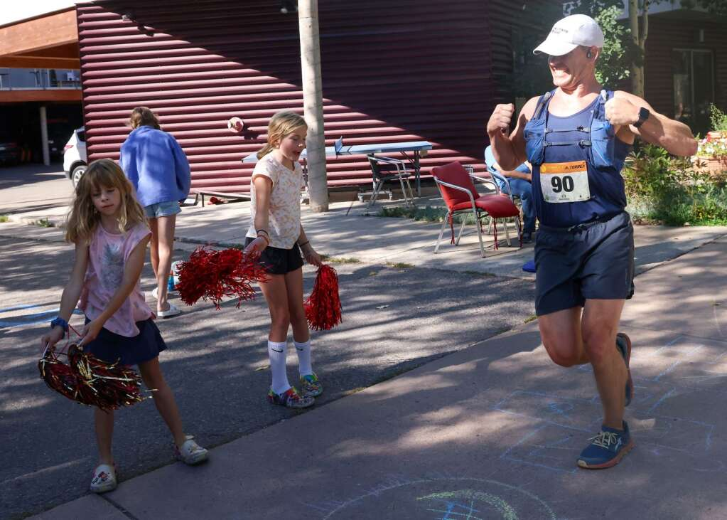 Boulder's Jacob Durling is cheered on during the Golden Leaf half marathon on Saturday, Sept. 18, 2021, in Aspen. Photo by Austin Colbert/The Aspen Times.