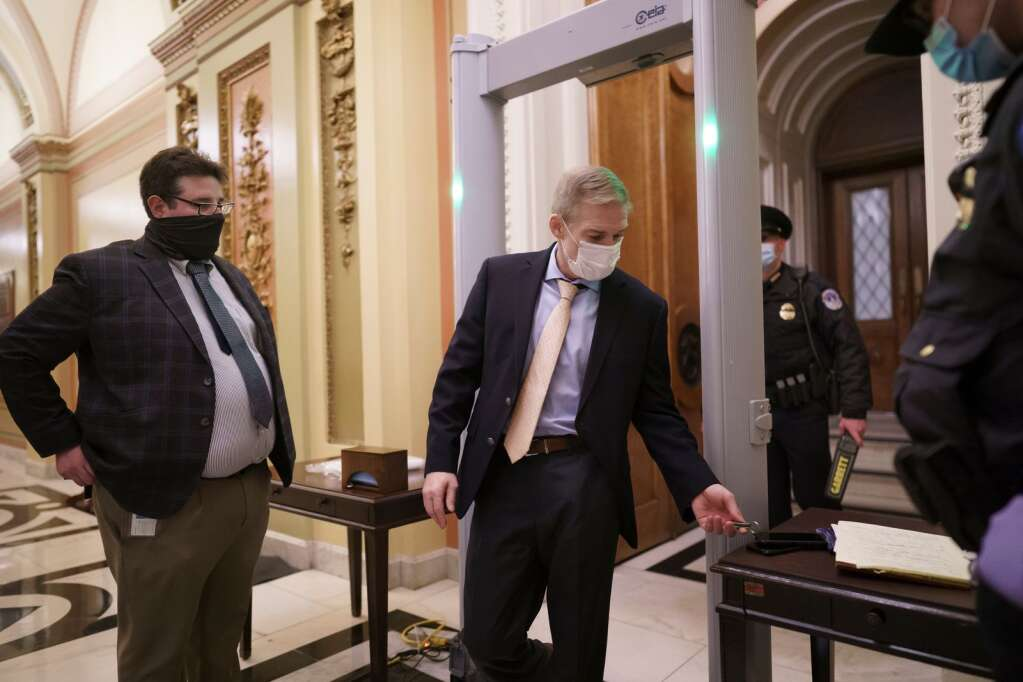 Rep. Jim Jordan, R-Ohio, an ally of President Donald Trump, passes through a metal detector as he enters the House chamber, new security measures put into place after a mob loyal to Trump stormed the Capitol, in Washington, Tuesday, Jan. 12, 2021. Democrats are set to pass a resolution calling on Vice President Mike Pence to invoke constitutional authority under the 25th Amendment to oust Trump.  (AP Photo/J. Scott Applewhite)