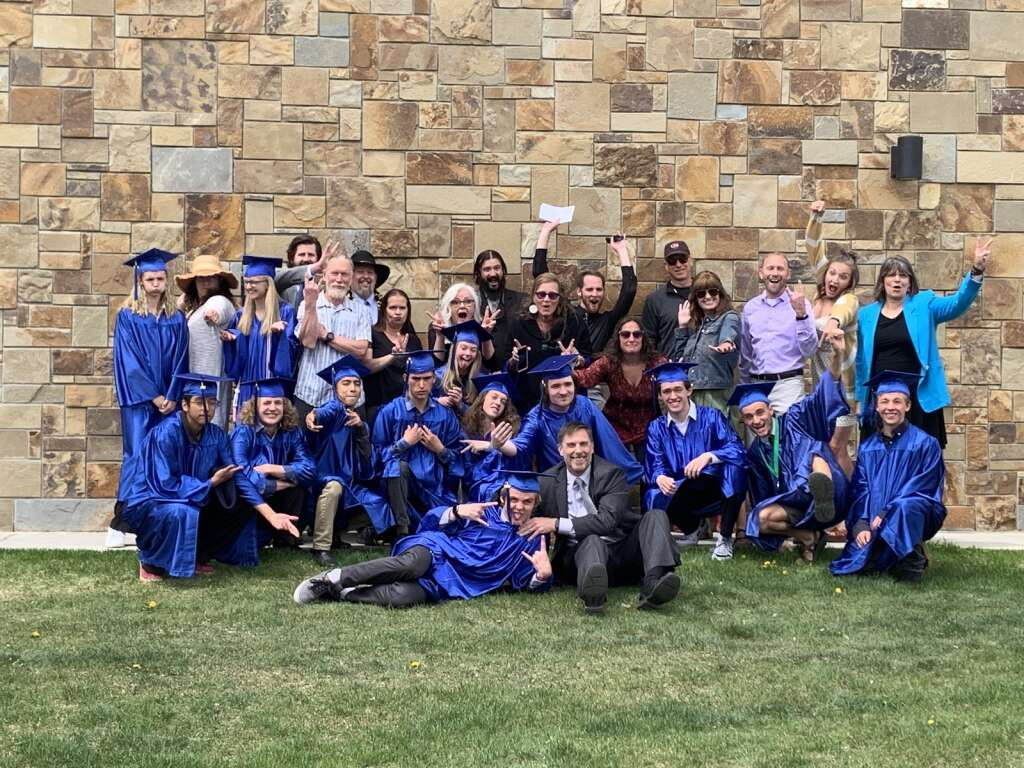 Students from the Snowy Peaks High School class of 2021 celebrate their graduation with teachers and staff members Wednesday, May 26, in Silverthorne.   Photo by Sawyer D'Argonne / sdargonne