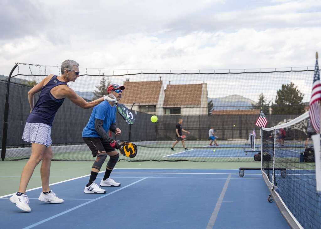 Myrna Lueck returns a volley during a pickleball matchup at the PC MARC during the club's marathon event Saturday morning, Sept. 11, 2021. (Tanzi Propst/Park Record)