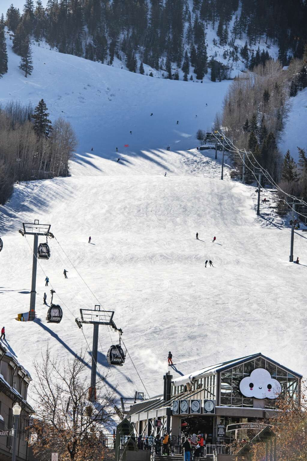 Skiers carve down Little Nell to the Silver Queen Gondola with a FriendsWithYou Little Cloud installation at Aspen Mountain on Wednesday, Jan. 6, 2021. (Kelsey Brunner/The Aspen Times)