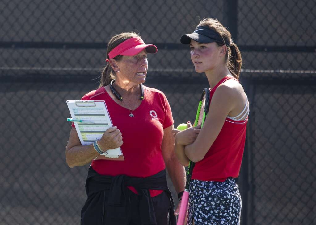 Park City High School Varsity Tennis Coach Lani Wilcox, left, speaks with sophomore third doubles player Reagan Harrison between matches on court 9 during the Miners' matchup against Olympus at the PC MARC Wednesday afternoon, Sept. 8, 2021. (Tanzi Propst/Park Record)