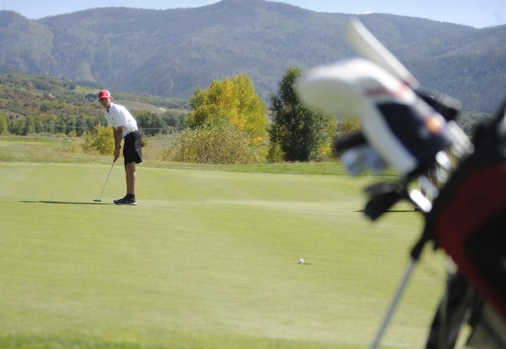 Steamboat Springs senior golfer Travis Seitz nails a putt at the Steamboat Sailor Invitational at Haymaker Golf Course on Tuesday. | Shelby Reardon/Steamboat Pilot & Today