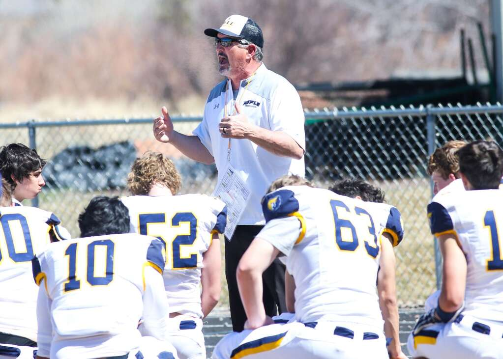Rifle football coach Todd Casebier talks to the players during halftime against Basalt on Saturday, April 3, 2021, on the BHS field. The Longhorns won, 38-7. Photo by Austin Colbert/The Aspen Times.