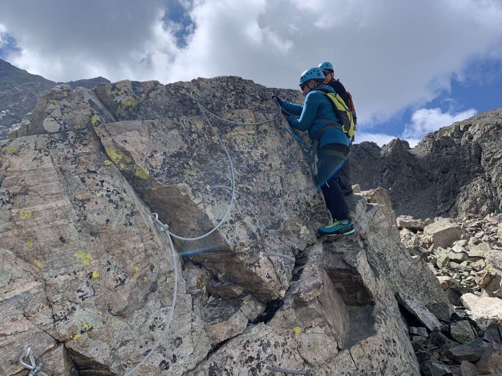 Arapahoe Basin Ski Area via ferrata guests Anna and Steve Clendenen practice using their safety equipment on the Schoolhouse Rock boulder and via ferrata course before climbing the via ferrata course proper on the East Wall on Tuesday, June 29.   Photo by Antonio Olivero / aolivero@summitdaily.com